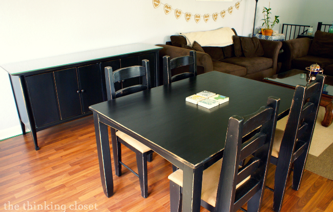Black Distressed Table, Chairs, and Buffet via The Thinking Closet