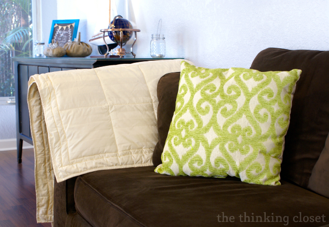 Decorative pillows can help transition a couch into a new season.