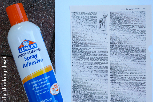 Spray adhesive used to adhere book page to cardstock.