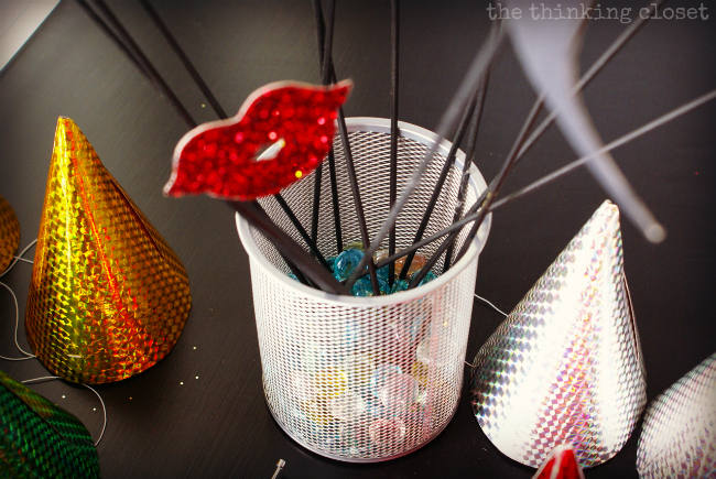 DIY Photo Booth Props at the ready!  Party time, people.  via thinkingcloset.com