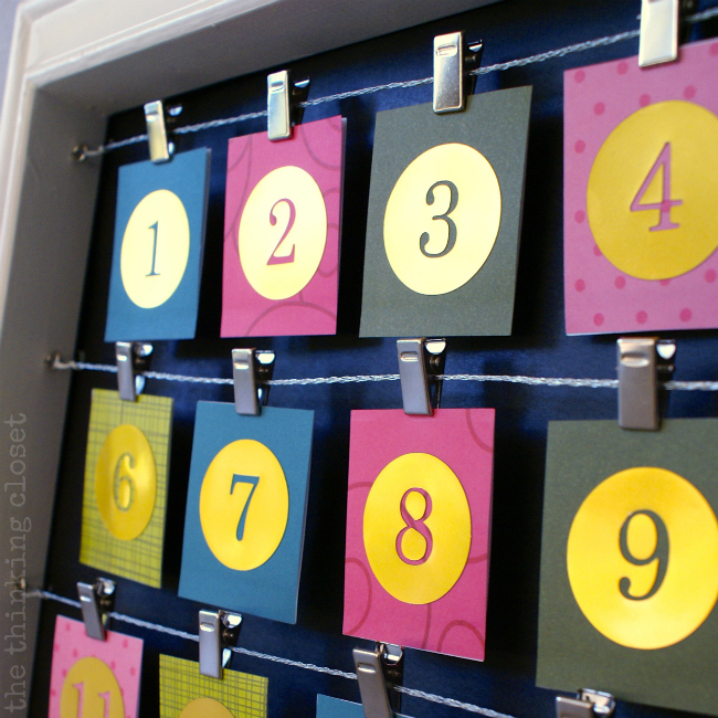 DIY Advent Calendar...Gold numbers on one side - - flip them over to reveal Instagram photos from the past year!
