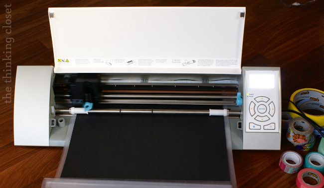 Silhouette machine, hard at work, cutting adhesive-backed cardstock!