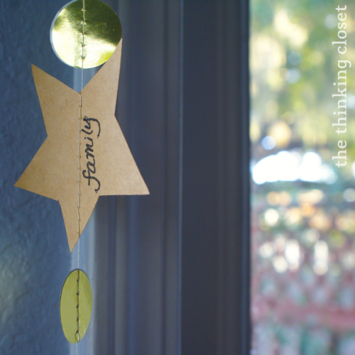 Gratitude Garland ~ Transitions from Thanksgiving into Christmas decor.  via thinkingcloset.com