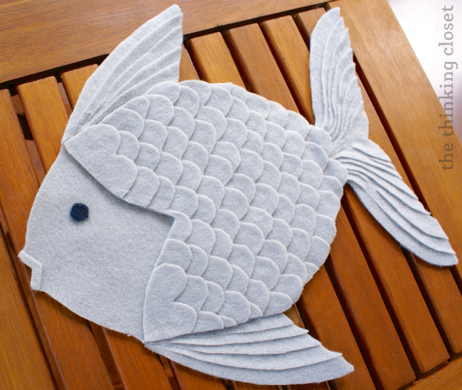 Completed felt fish...ready to be glued onto my envelope pillow cover! via thinkingcloset.com