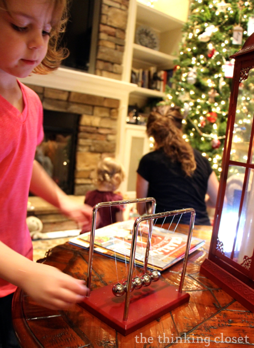 Cora explores Newton's Cradle.