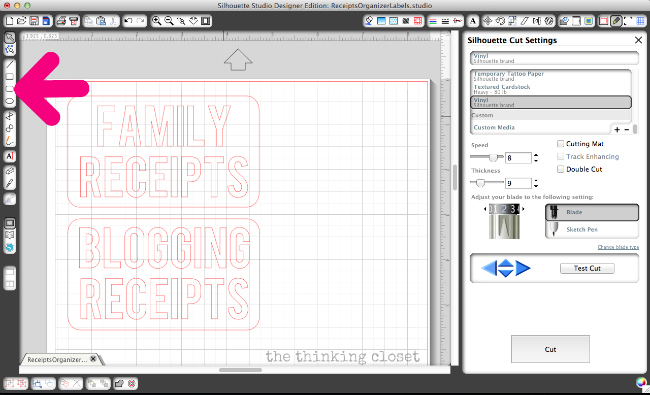 Creating vinyl labels for a receipt organizer.