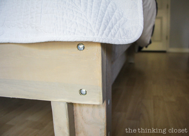 How to Build a Custom King Size Bed Frame via thinkingcloset.com.  Tightening the bolts.