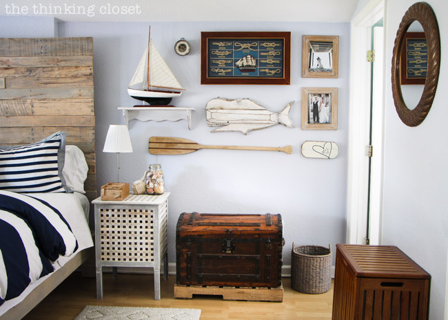 Unique Gallery Wall...part of a Rustic Nautical Master Bedroom Makeover via thinkingcloset.com
