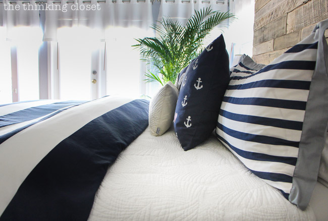 D.I.Y. Throw Pillows...just another piece of the puzzle in this dramatic Nautical Rustic Master Bedroom Makeover!  via thinkingcloset.com
