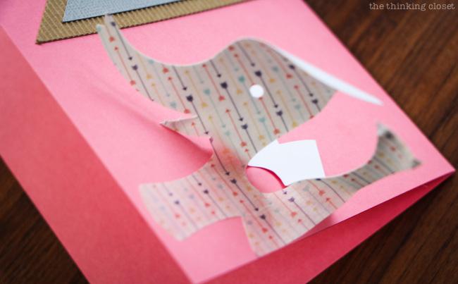 Applying a washi shape to a new baby congrats cards!  via thinkingcloset.com