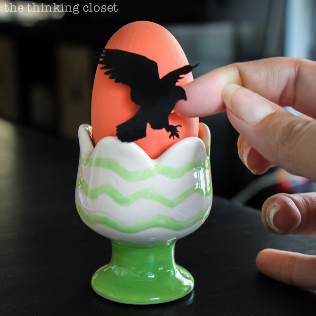 Placing the vinyl bird silhouettes onto the Easter eggs!