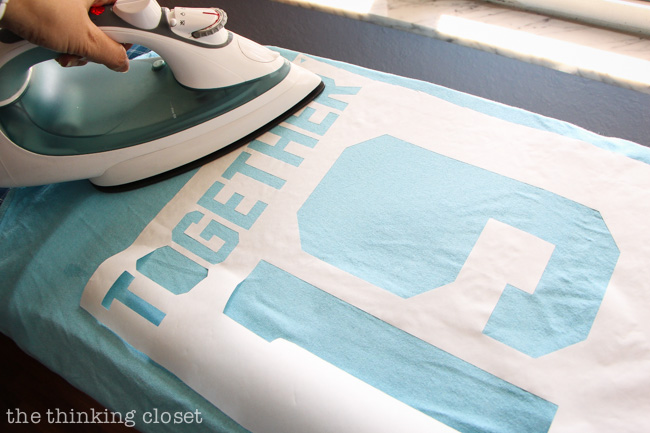 Ironing down your freezer paper stencil via thinkingcloset.com