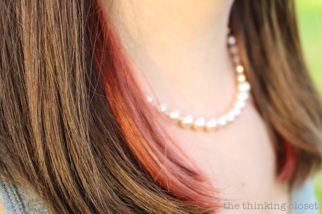 The red peek-a-boo highlights!  Peeking out.  via thinkingcloset.com