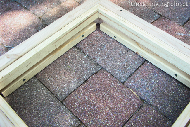 Part of the process of building the Rustic Pallet Recycle Bin!  via thinkingcloset.com