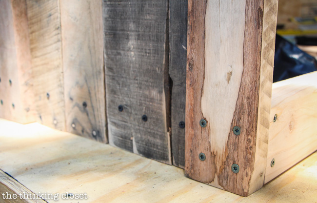 Creating the side walls of the Pallet Recycle Bin using reclaimed wood via thinkingcloset.com