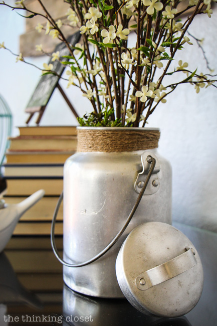 Rustic Vintage Spring Mantel: think outside the box when it comes to vases. A vintage camping jug will do just fine!  via thinkingcloset.com