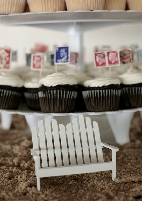 """For a beach wedding, use brown sugar and dollhouse furniture to create a little """"beach display"""" around your cake or cupcakes!"""