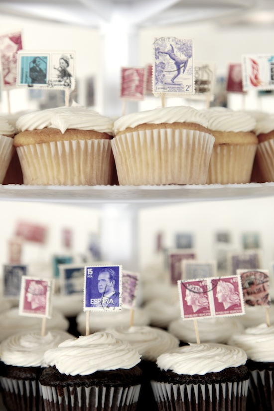 Stamp Flag Cupcake Toppers!  A great way to showcase a vintage stamp collection at a wedding or special event.  You can choose stamps of a particular color scheme to unite them.