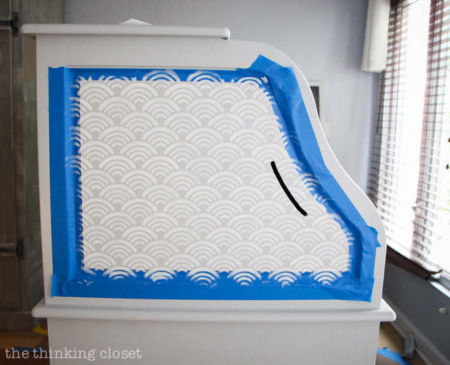 How to work a stencil into the recessed panel of a piece of furniture.