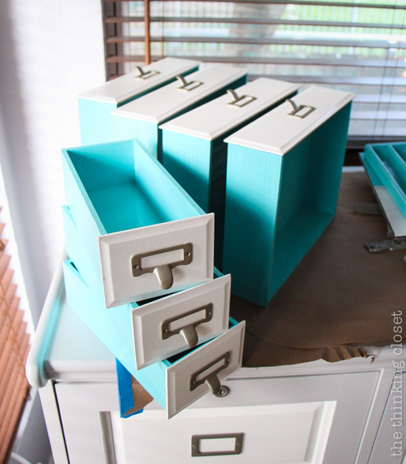 Roll-Top Desk Makeover in process...tiny drawers drying in the daylight.