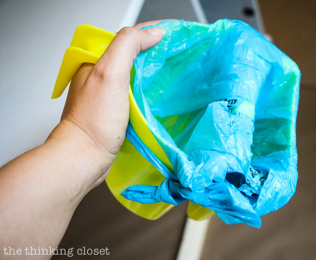 Line your hand-held paint bucket with a plastic bag for quick n' easy clean-up. Genius!