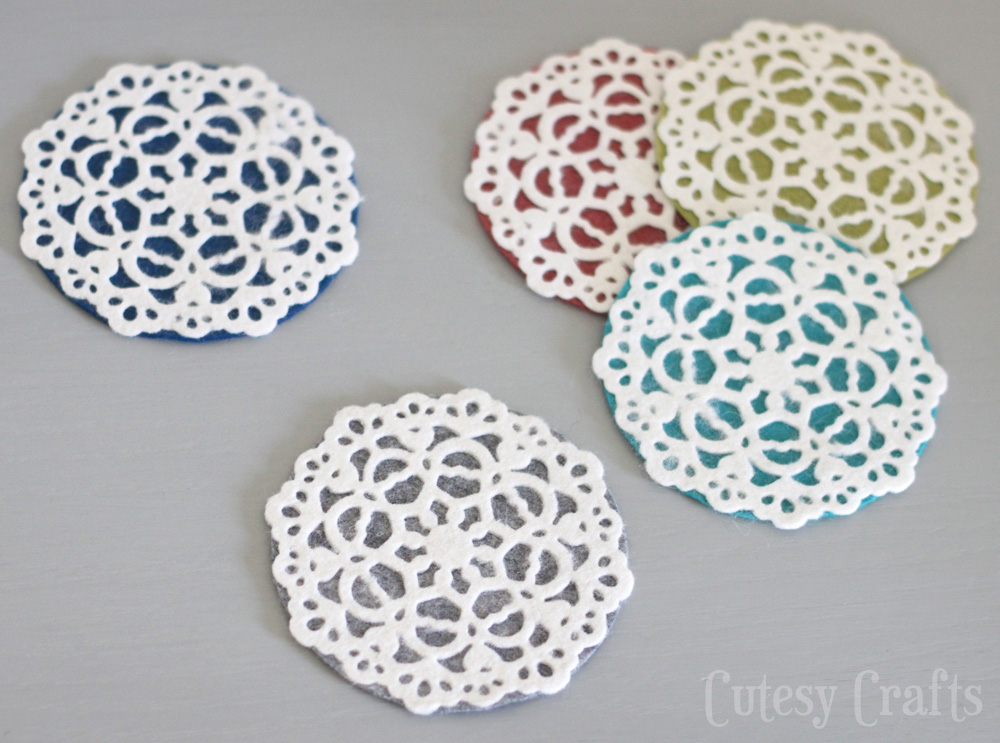 Felt Doily Coasters by Cutesy Crafts | One of a HUGE collection of DIY Drink Coasters over at thinkingcloset.com.  Such great gift ideas!