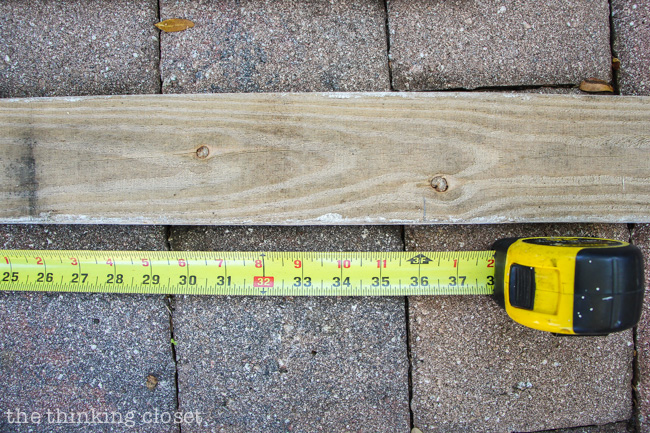 Measuring out the pallet wood for our Rustic Pallet Christmas Tree