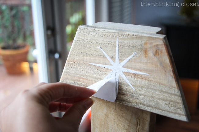 Peel away the vinyl stencil to reveal the finished Rustic Pallet Christmas Tree