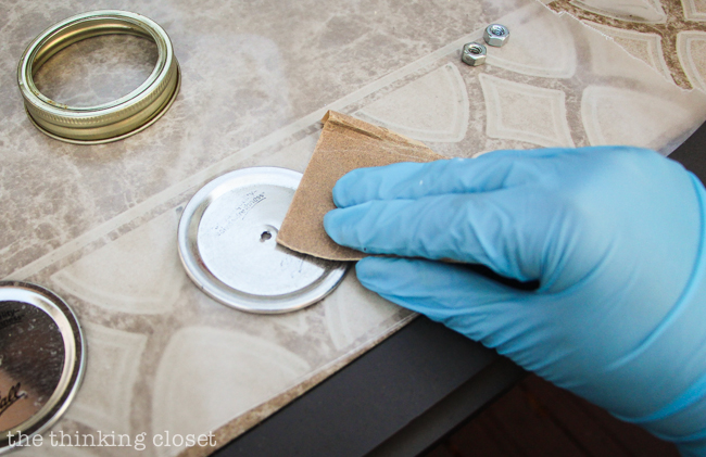 Swap It Like Its Hot: Fancy Dancy Mason Jar Upcycle     Prepping the lids for paint with sandpaper.