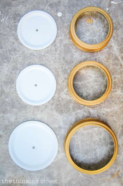 Swap It Like Its Hot: Fancy Dancy Mason Jar Upcycle  |  Modern Masters Metallic Paint in Olympic Gold helped give my mason jar lids a gilded gold look.  So chic!