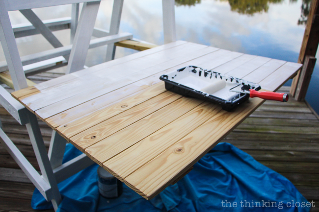 DIY Coastal Wood Plank Photo Backdrop  |  Time to apply the white outdoor paint!