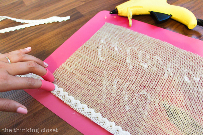 Love using my handy hot glue gun helper to adhere the lace to the burlap (without burning off my fingertips!).