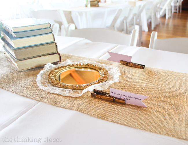 DIY Rustic Vintage Clothespin Place Card Holders | Love that can save on cost, but not scrimp on beauty with these gems! Step by step photo tutorial includes instructions on the easy method of staining the clothespins and how to design and cut the place card flags. Pop 'em in a vintage drawer with baby's breath and voila! Instant wedding whimsy!