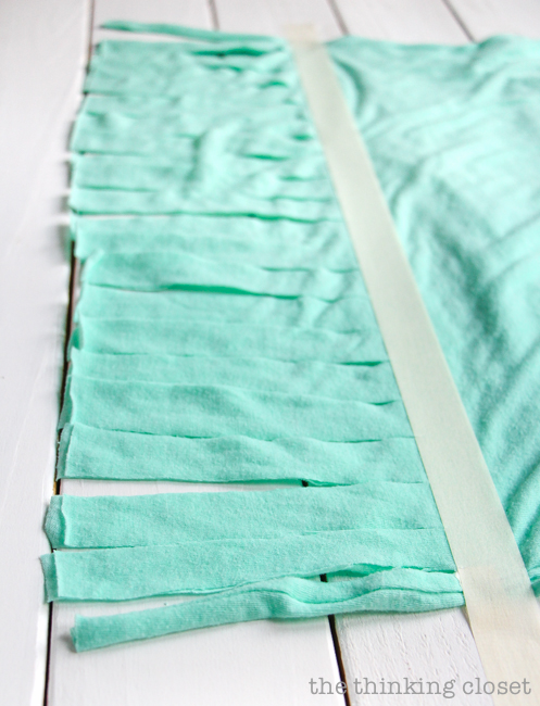 Step 3 of an easy, inexpensive, and FUN DIY scarf project: a 10 Minute Fringe Infinity T-Shirt Scarf.  Just one of many inspirational tutorials during Scarf Week!