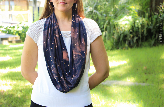 DIY Galaxy Print Infinity Scarf: Just one of the many inspirational tutorials during Scarf Week 2015.  This creative project uses the power of bleach on a dark t-shirt to transform it into a fabulous galactic accessory!  And you likely have most the supplies you'd need already lying around the house!
