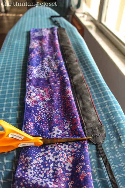 Cutting the scarf!  Just another step in the DIY Scarf Camera Strap Tutorial: Upcycle a scarf into a snazzy camera strap that will quickly become your new favorite accessory. This sewing tutorial will walk you through each step of the fun refashion. Happy Scarf Week 2015!