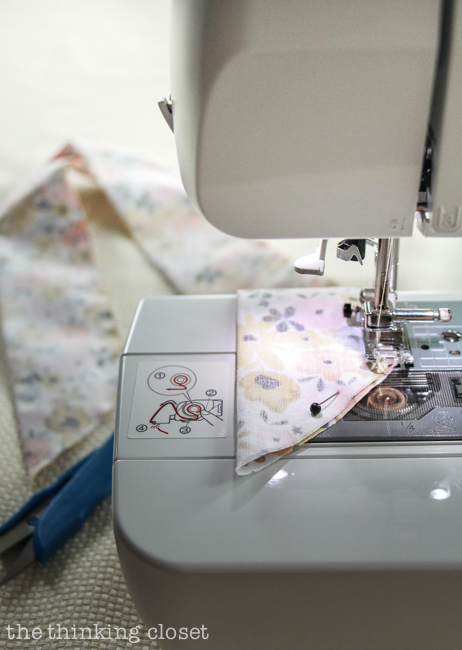 Stitching down the strip of fabric. Another step in creating your very own DIY Wire Head Scarf, an inspirational tutorial from Scarf Week 2015.  Such a fun beginner sewing project anyone can do!
