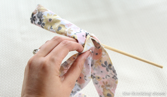 Turning your scarf right side out. Another step in creating your very own DIY Wire Head Scarf, an inspirational tutorial from Scarf Week 2015.  Such a fun beginner sewing project anyone can do!