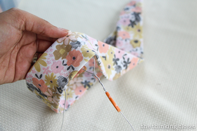 Feeding the wire into the scarf. Another step in creating your very own DIY Wire Head Scarf, an inspirational tutorial from Scarf Week 2015. Such a fun beginner sewing project anyone can do!