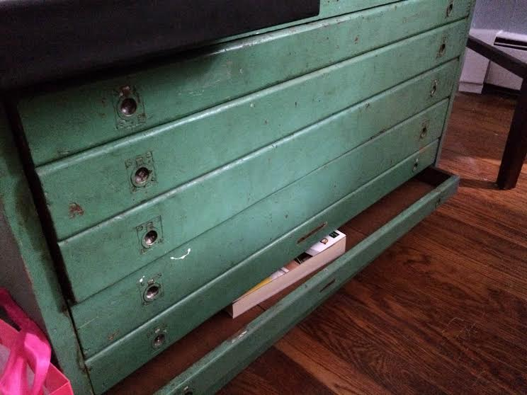 The vintage drawers that would be the perfect display for our rustic wedding place cards and their clothespin holders!