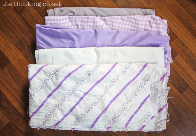 D.I.Y. Shabby Chic Fabric Photo Booth Backdrop   Variety of fabrics in our muted purple color palette, all ready to be shredded into strips!