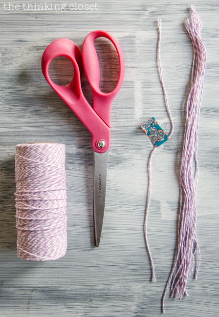 DIY Bookmark Wedding Favors - - perfect for the book-lovin' bride and groom! And you can't beat a price-point of 50 cents per bookmark! Here's a photo of our baker's twine for the tassels.