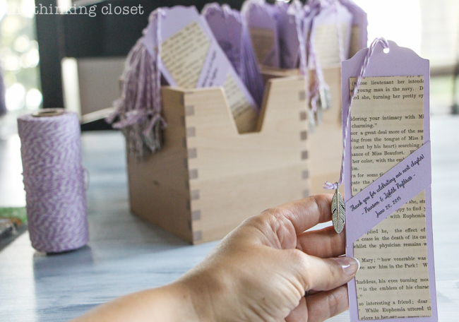 DIY Bookmark Wedding Favors - - perfect for the book-lovin' bride and groom! And you can't beat a price-point of 50 cents per bookmark! Nab the free cut file for your Silhouette, then prepare to wow those wedding guests with all of the whimsical, handmade touches on these favors!