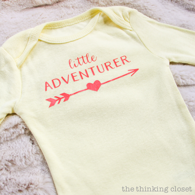 "3 Creative Onesies for Baby Girl & FREE Silhouette Cut Files | Here's a fun one for a ""Little Adventurer."" Customize your HTV or even your arrow to fit a boy, girl, or work as a gender neutral baby shower gift. Totally adorbs! And this post has tons of great tips for working with HTV (heat transfer vinyl)."