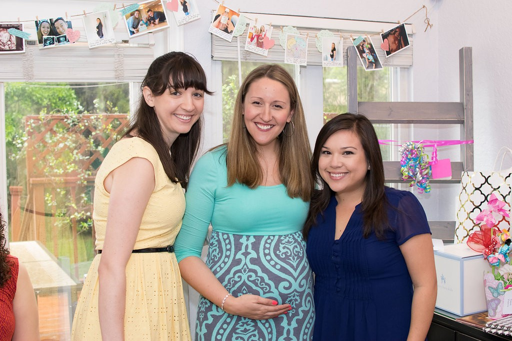 Pregnancy Milestone Timeline Banner: From Party Decor to Baby Scrapbook! | Here's how I saved time and money creating a simple photo banner garland for my baby shower. All of the banner elements can be popped into a scrapbook or baby book! Gotta love double-duty crafting.