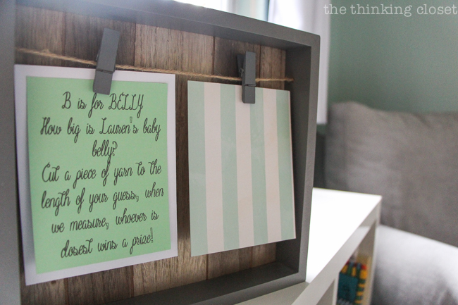 "Charming Mint & Gray Baby Shower | Inspiration for planning a meaningful baby shower for a mom-to-be with creative ideas for decor, food, games, activities, a guest book, favors, and more! Here's a glimpse at the instructions for guessing the ""girth"" of the mama's belly!"