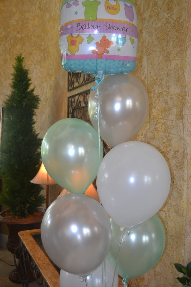 Charming Mint & Gray Baby Shower | Inspiration for planning a meaningful baby shower for a mom-to-be with creative ideas for decor, food, games, activities, a guest book, favors, and more! Here's a glimpse at the decor that perfectly matched the mint and gray color palette!
