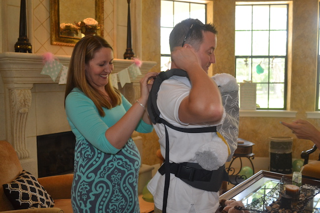 Hubby stole the show when he made a surprise entrance wearing a Tula Baby Carrier...but holding a stuffed dog inside for practice!