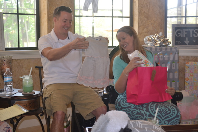 Charming Mint & Gray Baby Shower | Inspiration for planning a meaningful baby shower for a mom-to-be with creative ideas for decor, food, games, activities, a guest book, favors, and more! Here's a glimpse the mama and papa to be opening their gifts....