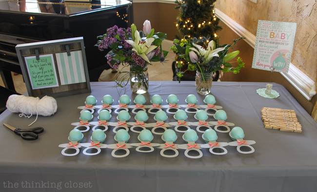 Charming Mint & Gray Baby Shower | Inspiration for planning a meaningful baby shower for a mom-to-be with creative ideas for decor, food, games, activities, a guest book, favors, and more! Here's the entryway table with fun activities and goodies for guests!